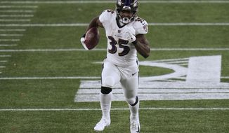 Baltimore Ravens running back Gus Edwards gains yardage against the New England Patriots in the first half of an NFL football game, Sunday, Nov. 15, 2020, in Foxborough, Mass. (AP Photo/Charles Krupa)
