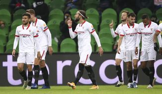 Sevilla players celebrate after scoring their side's first goal during the UEFA Champions League, group E, soccer match, between Krasnodar and Sevilla at the Krasnodar Stadium in Krasnodar, Russia, Tuesday, Nov. 24, 2020. (AP Photo)
