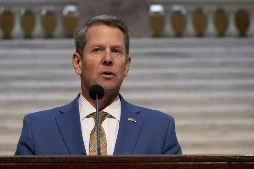 Brian Kemp holds a news conference on the current state of COVID-19, Tuesday, Nov. 24, 2020 at the Georgia State Capitol in Atlanta.  (Ben Gray /Atlanta Journal-Constitution via AP)