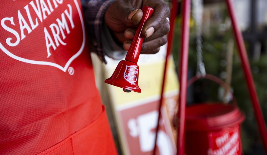 The Salvation Army's bell ringer Ivory Carter Sr. rings a bell to raise funds for The Salvation Army outside the Market Street store on 42nd Street Monday, Nov. 23, 2020, in Odessa, Texas.  (Jacob Ford/Odessa American via AP) ** FILE **