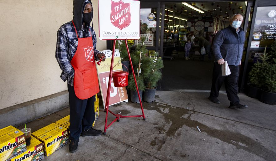 The Salvation Army's bell ringer Ivory Carter Sr. rings a bell to raise funds for The Salvation Army outside the Market Street store on 42nd Street Monday, Nov. 23, 2020, in Odessa, Texas.  (Jacob Ford/Odessa American via AP)
