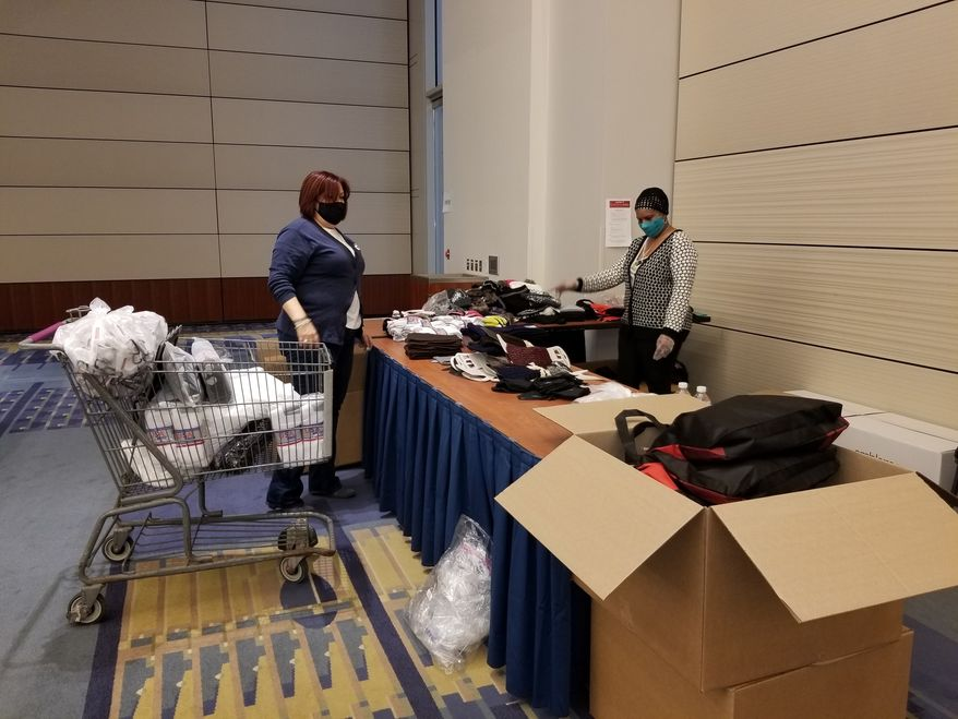 For the 21st annual Feast of Sharing event, Safeway and Events DC on Tuesday distributed thousands of Thanksgiving meal boxes and gift bags to local nonprofits to distribute to those in need.  (Courtesy of Safeway)