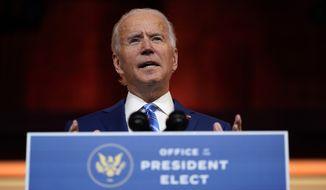 President-elect Joe Biden speaks at The Queen theater, Wednesday, Nov. 25, 2020, in Wilmington, Del. (AP Photo/Carolyn Kaster)