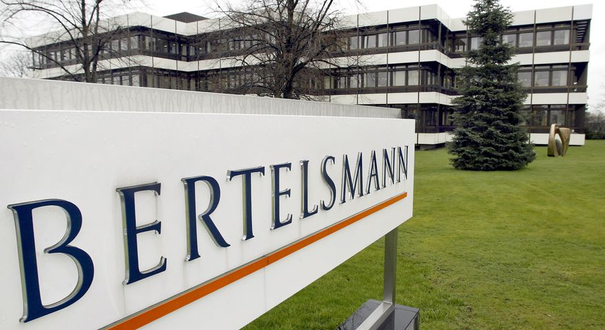 This March 13, 2003 file photo shows an exterior view of the German media giant Bertelsmann in Guetersloh, Germany. German media giant Bertelsmann said Wednesday that it is buying publisher Simon & Schuster from ViacomCBS for $2.17 billion in cash. (AP Photo/Michael Sohn, file)  **FILE**