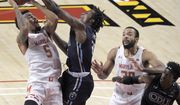 Maryland guard Eric Ayala (5) powers a shot past the outstretched past Old Dominion forward Austin Trice during the second half of an NCAA college basketball game in College Park, Md., Wednesday, Nov. 25, 2020. (Karl Merton Ferron/The Baltimore Sun via AP)