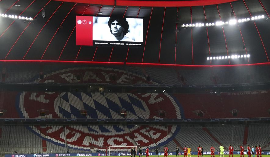 Players observe a minute of silence for the recently deceased Argentinian soccer legend Diego Maradona prior the start of the Champions League Group A soccer match between Bayern Munich and RB Salzburg at the Allianz Arena in Munich, Czech Republic, Wednesday, Nov. 25, 2020. (AP Photo/Matthias Schrader)