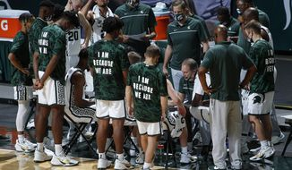 Michigan State coach Tom Izzo talks to his team during a timeout during the first half of the team's NCAA college basketball game against Eastern Michigan, Wednesday, Nov. 25, 2020, in East Lansing, Mich. Michigan State won 83-67. (AP Photo/Al Goldis)