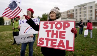 Supporters of President Donald Trump gather outside of the Wyndham Hotel where the Pennsylvania State Senate Majority Policy Committee is scheduled to meet, Wednesday, Nov. 25, 2020, in Gettysburg, Pa. (AP Photo/Julio Cortez)