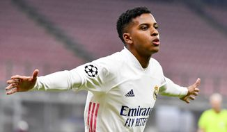 Real Madrid's Rodrygo Goes celebrates after scoring during the Group B, Champions League soccer match between Inter Milan and Real Madrid at the San Siro Stadium, in Milan, Italy, Wednesday, Nov. 25, 2020. (Marco Alpozzi/LaPresse via AP)