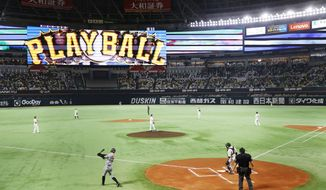 Players of the Fukuoka Softbank Hawks and Yomiuri Giants play Wednesday, Nov. 25, 2020, during the forth game of the 2020 Japan Series at PayPay Dome in Fukuoka, Western Japan. (Kyodo News via AP)