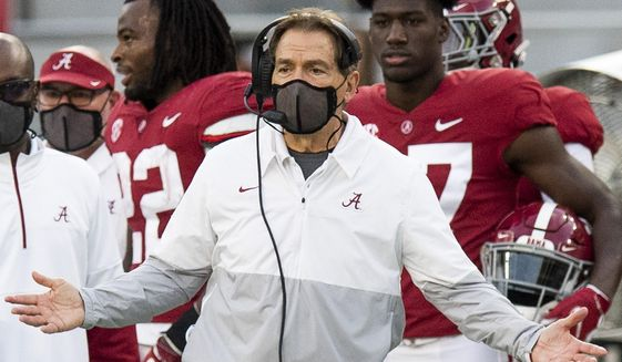 Alabama coach Nick Saban gestures during the team's NCAA college football game against Kentucky on Saturday, Nov. 21, 2020, in Tuscaloosa, Ala. (Mickey Welsh/The Montgomery Advertiser via AP) **FILE**