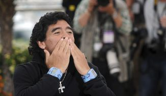 Diego Maradona blows a kiss to fans in Cannes, France, on May 20, 2008. Diego Maradona has died. The Argentine soccer great was among the best players ever and who led his country to the 1986 World Cup title before later struggling with cocaine use and obesity. He was 60. (Gian Mattia D'Alberto/LaPresse via AP)