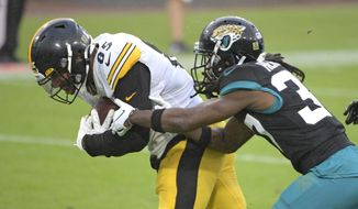 Pittsburgh Steelers tight end Eric Ebron, left, gets by Jacksonville Jaguars cornerback Tre Herndon for a touchdown during the second half of an NFL football game, Sunday, Nov. 22, 2020, in Jacksonville, Fla. (AP Photo/Phelan M. Ebenhack)