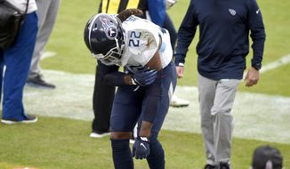 Tennessee Titans running back Derrick Henry reacts after taking a hit while running with the ball against the Baltimore Ravens during the second half of an NFL football game, Sunday, Nov. 22, 2020, in Baltimore. (AP Photo/Gail Burton)