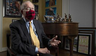 Sen. Lamar Alexander, R-Tenn., speaks from behind a face mask during an interview Friday, Nov. 20, 2020, in Nashville, Tenn. (AP Photo/Wade Payne)
