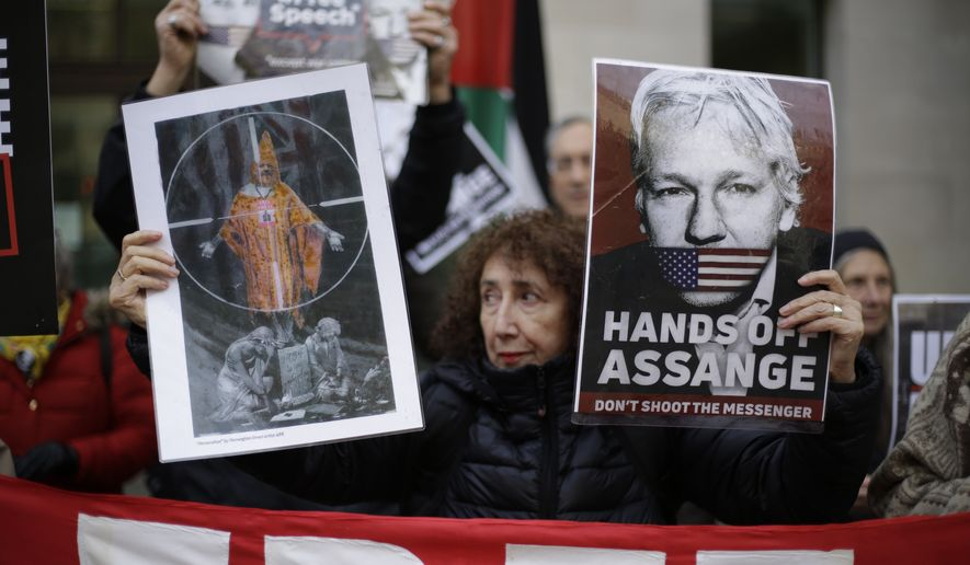 Supporters of WikiLeaks founder Julian Assange take part in a protest outside Westminster Magistrates Court in London, to support him in a administrative hearing for his extradition case, Thursday, Nov. 26, 2020. Assange was unable to attend or appear by video link today due to a COVID-19 outbreak at Belmarsh prison where he is being held. (AP Photo/Matt Dunham)