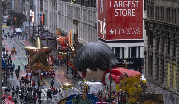 Floats that are part of the modified Macy's Thanksgiving Day Parade are seen from the Empire State Building in New York, Thursday, Nov. 26, 2020. Due to the pandemic, no crowds of onlookers were allowed to attend the annual parade. (AP Photo/Craig Ruttle)