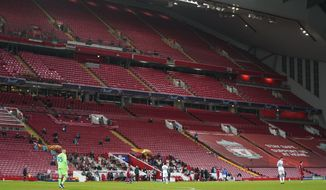 Players in action during the Champions League group D soccer match between Liverpool and Atalanta at Anfield stadium in Liverpool, England, Wednesday, Nov. 25, 2020. (AP Photo/Jon Super, Pool)
