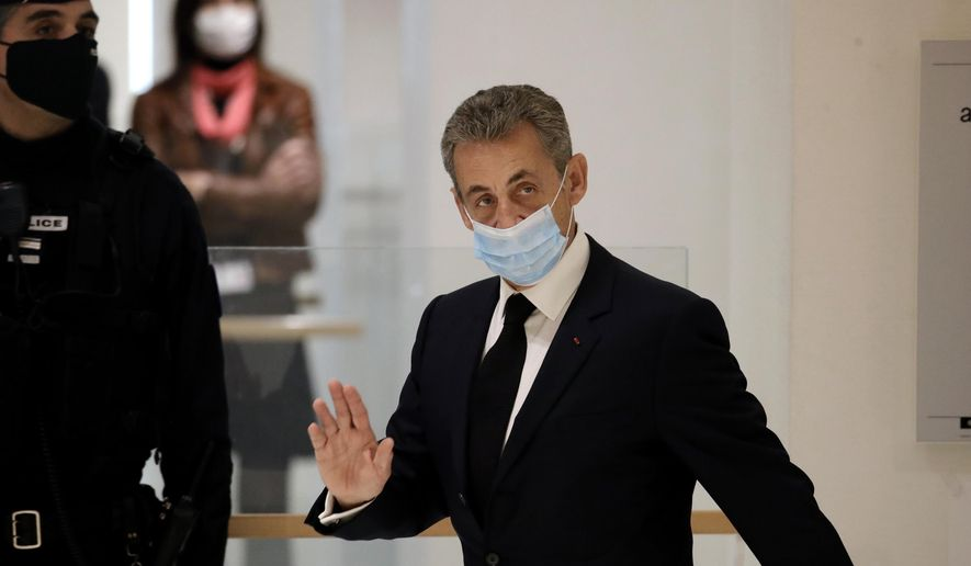 Former French President Nicolas Sarkozy arrives at the courtroom Thursday, Nov. 26, 2020 in Paris. Sarkozy goes on trial on charges of corruption and influence peddling in a phone-tapping scandal, a first for the 65-year-old politician who has faced several other judicial investigations since leaving office in 2012. (AP Photo/Christophe Ena)