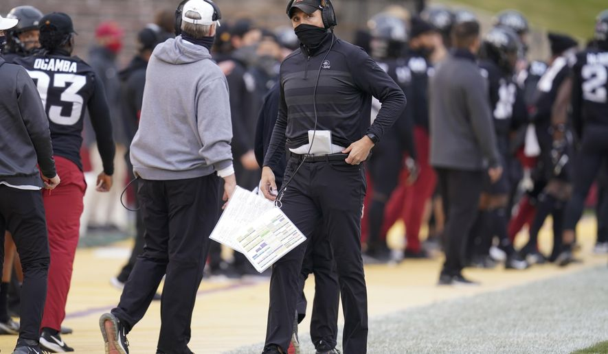 Iowa State head coach Matt Campbell, center, watches from the sideline during the first half of an NCAA college football game against Kansas State, Saturday, Nov. 21, 2020, in Ames, Iowa. Iowa State won 45-0. (AP Photo/Charlie Neibergall)