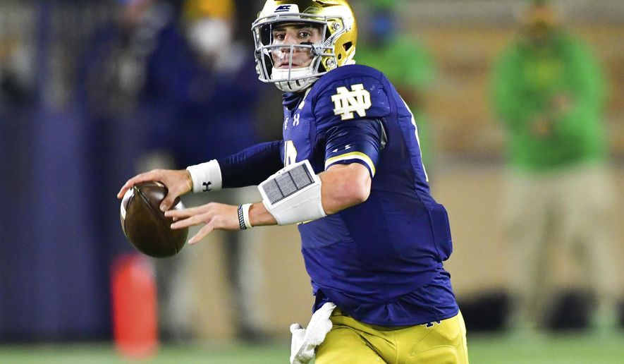 FILE - In this Nov. 7, 2020, file photo, Notre Dame quarterback Ian Book looks for a receiver during the first quarter of an NCAA college football game against Clemson in South Bend, Ind. Book's second-ranked Fighting Irish visit No. 25 North Carolina on Friday. (Matt Cashore/Pool Photo via AP, File)
