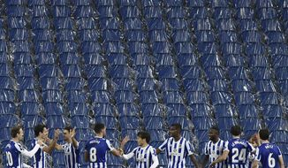 Real Sociedad players celebrate after Portu scored his side's opening goal during the Europa League Group F soccer match between Real Sociedad and AZ Alkmaar at the Anoeta stadium in San Sebastian, Spain,Thursday, Nov 5, 2020. (AP Photo/Alvaro Barrientos)