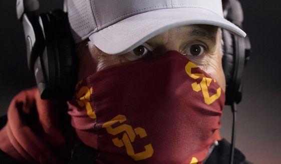 Southern California head coach Clay Helton looks on following an NCAA college football game against Utah Sunday, Nov. 22, 2020, in Salt Lake City. (AP Photo/Rick Bowmer)