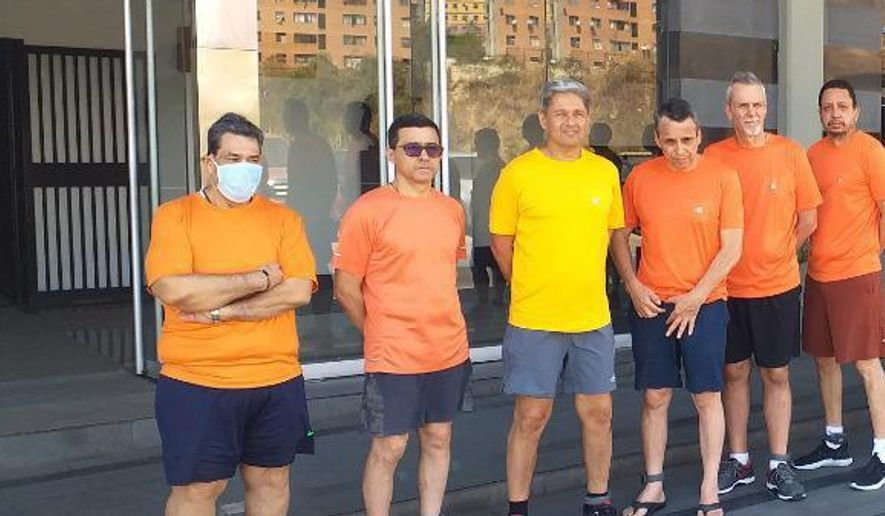 CITGO oil executives Jose Angel Pereira, from left to right, Gustavo Cardenas, Jorge Toledo, Jose Luis Zambrano, Tomeu Vadell and Alirio Jose Zambrano, standing outside the Bolivarian National Intelligence Service, in Caracas, Venezuela. (Posted on Twitter by Jorge Arreaza/Venezuela's Foreign Ministry via AP File)