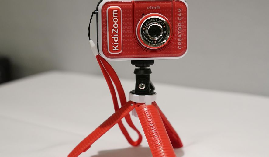 A KidiZoom Creator Cam by VTech is displayed at the Toy Fair, Thursday, Sept. 17, 2020, in New York. The digital camera comes with a green screen and animated backgrounds allowing kids to go to outer space, get chased by T-Rex, or make things disappear. The camera comes with a tabletop tripod, which can also be used as a selfie stick. (AP Photo/Kathy Willens)
