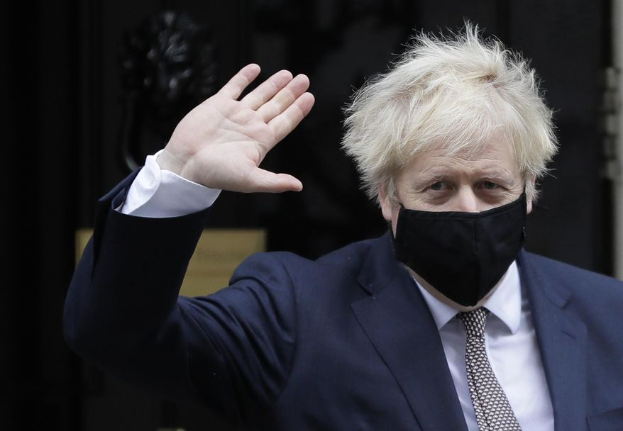 Britain's Prime Minister Boris Johnson waves as he leaves 10 Downing Street in London, Thursday, Nov. 26, 2020. Johnson leaves self-quarantine today after having close contact with a lawmaker who contracted the coronavirus in mid November. (AP Photo/Kirsty Wigglesworth)