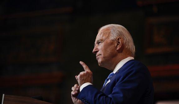 Presumed President-elect Joesph R. Biden Jr. speaks in Wilmington, Del. (AP Photo/Carolyn Kaster, File)