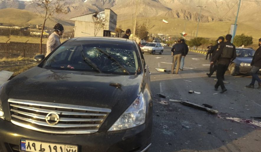 This photo released by the semi-official Fars News Agency shows the scene where Mohsen Fakhrizadeh was killed in Absard, a small city just east of the capital, Tehran, Iran, Friday, Nov. 27, 2020.  Fakhrizadeh, an Iranian scientist that Israel alleged led the Islamic Republic's military nuclear program until its disbanding in the early 2000s was assassinated Friday, state television said.  (Fars News Agency via AP)