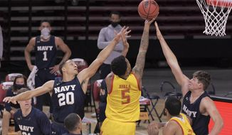 Navy guard Greg Summers (20) and forward Daniel Deaver fail to stop Maryland guard Eric Ayala (5) from scoring during an NCAA college basketball game Friday, Nov. 27, 2020, in College Park, Md. (Karl Merton Ferron/The Baltimore Sun via AP)