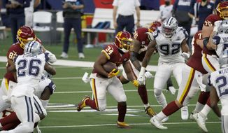 Washington Football Team running back Peyton Barber (34) looks for room to run during the first half of an NFL football game against the Dallas Cowboys in Arlington, Texas, Thursday, Nov. 26, 2020. (AP Photo/Roger Steinman)  **FILE**