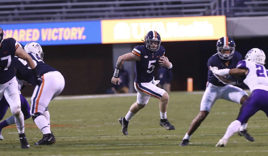 Virginia quarterback Brennan Armstrong (5) runs the ball against Abilene Christian during an NCAA college football game Saturday, Nov. 21, 2020, in Charlottesville, Va. (Erin Edgerton/The Daily Progress via AP)
