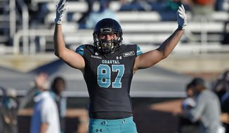 Coastal Carolina's Michael McFarlane reacts during the second half of an NCAA college football game against Appalachian State, Saturday, Nov. 21, 2020, in Conway, S.C. Coastal Carolina won 34-23. (AP Photo/Richard Shiro)