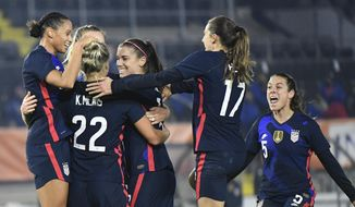 United States players celebrate with Kristie Mewis, number 22, who scored her side's second goal during the international friendly women's soccer match between The Netherlands and the US at the Rat Verlegh stadium in Breda, southern Netherlands, Friday Nov. 27, 2020. (Piroschka van de Wouw/Pool via AP)  **FILE**