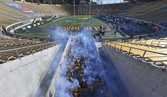 The California Golden Bears run into an empty Memorial Stadium for the 123rd Big Game, an NCAA college football game against Stanford Friday, Nov. 27, 2020, in Berkeley, Calif. (Jose Carlos Fajardo/Bay Area News Group via AP)
