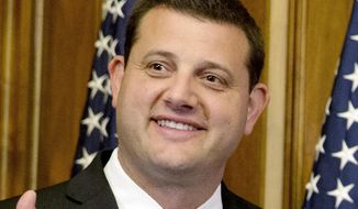 FILE - In this Jan. 6, 2015, file photo, Rep. David Valadao, R-Calif., poses during a ceremonial re-enactment of his swearing-in ceremony in the Rayburn Room on Capitol Hill in Washington. Valadao has reclaimed the U.S. House seat he lost in the California farm belt two years ago. (AP Photo/Jacquelyn Martin, File)