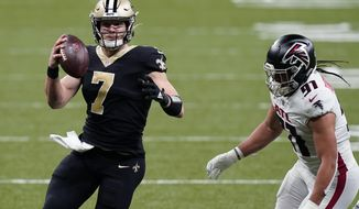 New Orleans Saints quarterback Taysom Hill (7) scrambles past Atlanta Falcons defensive tackle Jacob Tuioti-Mariner (91) in the first half of an NFL football game in New Orleans, Sunday, Nov. 22, 2020. (AP Photo/Butch Dill)