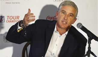 FILE - In this Sept. 2 2020 file photo, PGA Tour commissioner Jay Monahan holds a live press conference with the media during the season-ending Tour Championship at East Lake Golf Club, in Atlanta.   The PGA Tour and European Tour have announced an alliance on Friday, Nov. 27,  that could be the start of a global schedule.  Part of the alliance has the PGA Tour acquiring a minority share in European Tour Productions. (Curtis Compton/Atlanta Journal-Constitution via AP)