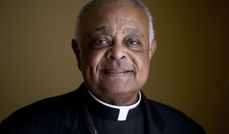 This Sunday, June 2, 2019, file photo shows Washington D.C. Archbishop Wilton Gregory posed for a portrait following mass at St. Augustine Church in Washington. (AP Photo/Andrew Harnik, File)  **FILE**