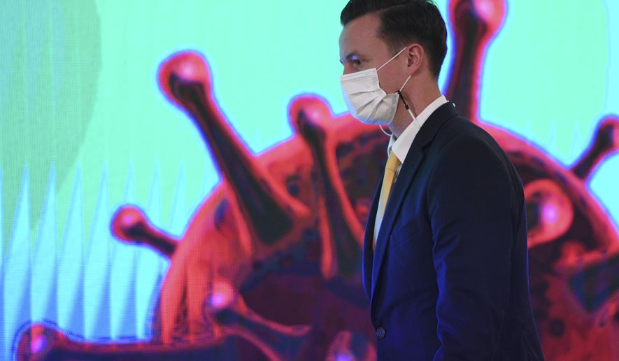 James Teague, president of AstraZeneca's in Thailand attends a signing ceremony at Government House in Bangkok, Thailand Friday, Nov. 27, 2020. Thailand on Friday signed a deal to procure 26 million doses of the trial coronavirus vaccine developed by pharmaceutical firm AstraZeneca in collaboration with Oxford University. (Chalinee Thirasupa/Pool Photo via AP)