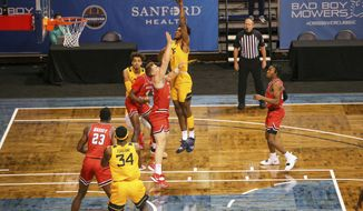 West Virginia forward Derek Culver (1) shoots over a Western Kentucky defender during the first half of an NCAA college basketball game Friday, Nov. 27, 2020, in SIoux Falls, S.D. (AP Photo/Josh Jurgens)