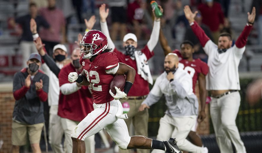 Alabama running back Najee Harris (22) scores a touchdown on a long run against Auburn during an NCAA college football game Saturday, Nov. 28, 2020, in Tuscaloosa, Ala. (Mickey Welsh/The Montgomery Advertiser via AP)  **FILE**