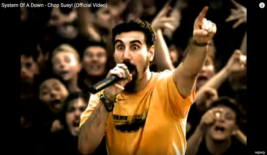 """Shown here is a screen capture of System of a Down's official music video for their hit song """"Chop Suey!"""" The video has surpassed 1 billion views on YouTube, the first time a song by a heavy metal band has met that milestone. (YouTube/System of a Down) [https://www.youtube.com/watch?v=CSvFpBOe8eY&ab_channel=systemofadownVEVO]"""