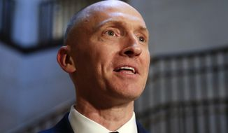 In this Nov. 2, 2017, photo, Carter Page, a foreign policy adviser to Donald Trump's 2016 presidential campaign, speaks with reporters following a day of questions from the House Intelligence Committee, on Capitol Hill in Washington. (AP Photo/J. Scott Applewhite)  **FILE**