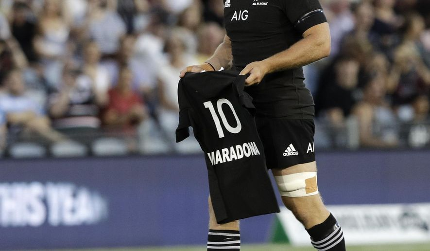 New Zealand captain Sam Cane lays All Black number 10 jersey on the pitch in memory of late Argentina soccer star Diego Maradona prior to the start Tri-Nations rugby test between Argentina and the All Blacks in Newcastle, Australia, Saturday, Nov. 28, 2020. (AP Photo/Rick Rycroft)