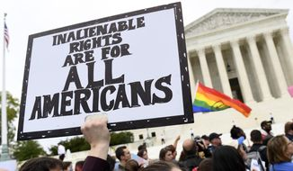 In this Oct. 8, 2019, photo, protesters gather outside the Supreme Court in Washington where the Supreme Court is hearing arguments in the first case of LGBT rights since the retirement of Supreme Court Justice Anthony Kennedy. As vice president in 2012, Joe Biden endeared himself to many LGBTQ Americans by endorsing same-sex marriage even before his boss, President Barack Obama. Now, as president-elect, Biden is making sweeping promises to LGBTQ activists, proposing to carry out virtually every major proposal on their wish lists. (AP Photo/Susan Walsh) **FILE**