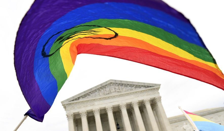 In this Oct. 8, 2019 file photo, protesters gather outside the Supreme Court in Washington where the Supreme Court is hearing arguments in the first case of LGBT rights since the retirement of Supreme Court Justice Anthony Kennedy.   As vice president in 2012, Joe Biden endeared himself to many LGBTQ Americans by endorsing same-sex marriage even before his boss, President Barack Obama. Now, as president-elect, Biden is making sweeping promises to LGBTQ activists, proposing to carry out virtually every major proposal on their wish lists. (AP Photo/Susan Walsh) **FILE**